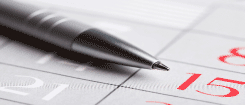 image of a pen on a calendar
