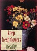 "Image of ""Keep Fresh Flowers Nearby"" page from ""Four Word Self Help"" book"