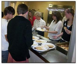 People volunteering at Greensboro Urban Ministry
